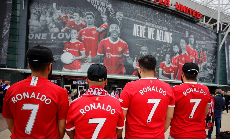 Поклонники «МЮ» носят теперь футболки с одними семерками. Фото: Reuters